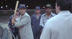 "Harry Dean Stanton (with baseball bat) as Bud in his starring role in ""Repo Man"""